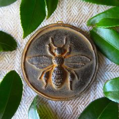 Beeswax -tinted black, and hand poured into an excellent reproduction of a heavily carved European cookie mold. Here is a single honey bee Hives And Honey, Honey Bees, Buzz Bee, Bee Free, I Love Bees, Vintage Bee, Bee Sting, Bee Design, Save The Bees