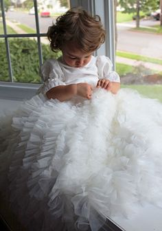 This dress is made from a designer that is committed to designing dresses of couture quality, designs, and LOTS of details. This dress is made from a designer that is committed to designing dresses of couture quality, unique designs, and LOTS of details. Watch your little one turn into a sweet angel instantly in this gorgeous gown. The multiple layers of organza give the dress a full and opulent look. The dress features button closure. This will surely be a memorable dress for her special…