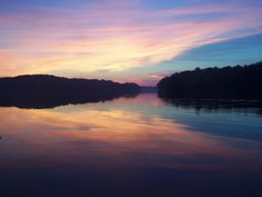 the multitude of colors of the sun setting on Mogadore Reservoir in Mogadore, Ohio