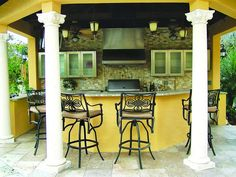 Yellow and black is an attractive color combination in this outdoor kitchen.