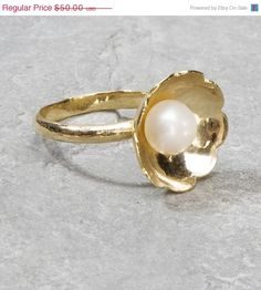 Check out this item in my Etsy shop https://www.etsy.com/listing/52659694/summer-sale-princess-pearl-ring-gold