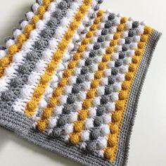 Custom order for na22ii. Grey and Mustard bobble blanket