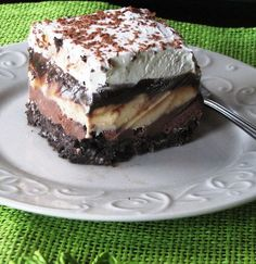 Dairy Queen copy cat ICE CREAM CAKE Ingredients: 2 1/2 cups crushed Oreos 1/2 cup melted butter 1/2 cup sugar 1/4-1/2 gallon chocolate ice cream, slightly softened 1/4-1/2 gallon vanilla ice cream, slightly softened 8 ounces Cool Whip Hot Fudge Sauce: 2 cup powdered sugar 2/3 cup semisweet chocolate chips 12 ounce can evaporated milk 1 stick margarine 1 teaspoon vanilla...yum!!!!!!!!!