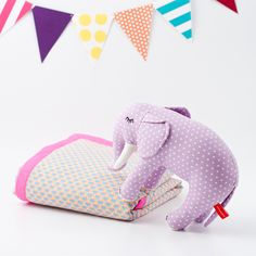With winter upon us and a chill in the air, warm, snuggly blankets, soft pillows and cuddly toys are officially a hot commodity in our house--the cuter, the better. Betcha you and yours will be smitten with this adorable, sunny-bright nursery collection as much as we are.