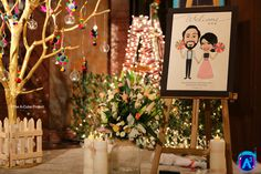 The personalised entrance executed by The A-Cube Project! Story boards with caricatures, gorgeous trees & colourful hangings & of course the fairy lights :)= magic #thedesivintagebride #theacubeproject