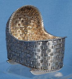 This is a very unusual item - Salt. Simulates woven cradle of the Victorian era, London, 1892.