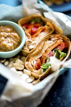 Thai Peanut Turkey Wrap | A simple turkey wrap filled with veggies and a tasty Thai peanut sauce | thealmondeater.com