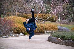 Stock Photo : Dancing breakdance on the Japanese park wearing Kimono