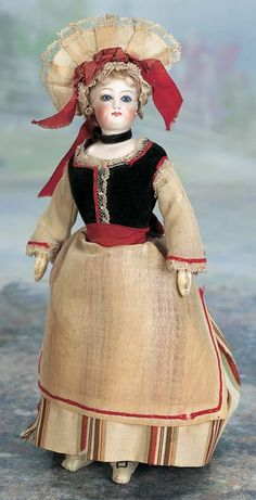 """. Petite French Bisque Poupee in Original Normandy Costume 11"""" (28 cm.) Bisque swivel head on kid-edged bisque shoulder"""