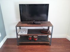 Old Barn Wood 3 Shelf Tv Console / Media Stand by ArtistandCarpenter on Etsy https://www.etsy.com/listing/181416816/old-barn-wood-3-shelf-tv-console-media
