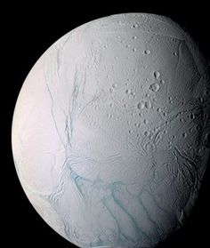 Enceladus, one of Saturn's moons.  The Cassini spacecraft captured an image of plumes originating from the south pole of the icy moon with a very clear signature of small ice particles. There is possible evidence of Yellowstone-like geysers fed by reservoirs of liquid water.