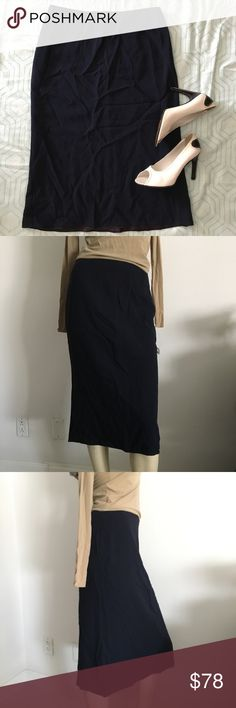 """Vintage Ralph Lauren navy skirt Ralph Lauren navy skirt. Hits below the knee, zips up in the back, fully lined. 51%wool 49%rayon. Made in USA 🇺🇸 size 6. Measurements taken laying flat and relaxed: waist-28"""", length-26"""" Ralph Lauren Blue Label Skirts Midi"""