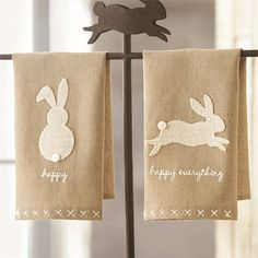 2 styles. Natural linen fingertip towels with white burlap bunnies and shell button tails feature cross-stitched hem. Individual wholesale price is $3.75 each.