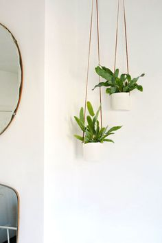 leather and clay hanging planters