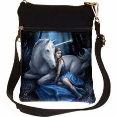 In a magical forest, moonlight streams through the branches at night. A white Unicorn sits serenely on the long grass, moonlight reflecting off their The Light Is Coming, Anne Stokes, White Unicorn, Magical Forest, Look At You, Blue Moon, Diaper Bag, Unicorns, Moonlight