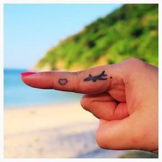 Pin for Later: 40 Tiny Tattoos For Travel-Lovers Tiny Finger Plane