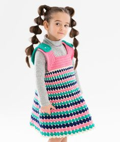 Toddler Joyful Jumper - This comfortable crochet jumper is striped in bright colors that are fun to wear and can be accessorized according to the season. Choose tested yarn with confidence. Look for the tested mark with the blue heart on the ball band.