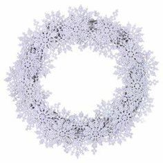 """Snowflake wreath with a natural twig base.  Product: WreathConstruction Material: Silicone and natural twigsColor: WhiteDimensions: 22"""" Diameter x 5"""" DCleaning and Care: Wipe gently with a dry cloth. Avoid sunlight and humidity."""