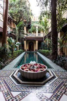 Fresh floating flower petals are sprinkled into the courtyard pools three times a week.