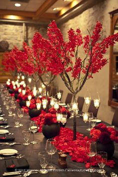 GV BD. Love red. On tables use lowe arrangements, with mirror tiles ans various height candles. Tall flowers and branches odpf same color can go somewhere else in the room/ reception