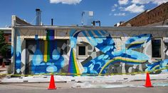 Many Hands, paint-by-number mural designed by Megan Meier. Summer 2015. Downtown Laramie. #laramiemuralproject #laramiemural #laramiemurals #manyhands