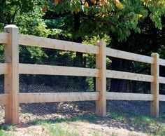 Natural Cedar Morgan Fence - This three rail Morgan fence was left natural and will weather to a soft gray overtime. The addition of wire makes this fence a functional animal enclosure.
