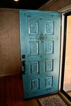 Blue glazed and weathered front door