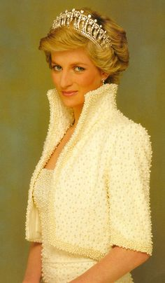 Princess Diana. I have a porcelain doll of her in this dress.