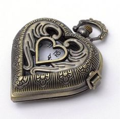 Vintage looking Heart shaped, Locket style, real working quartz pocket watch necklace pendant with a cut out heart on front Color - Antique bronze Chain - 32 long Size - 1 wide x 2 long Style - quartz pocket watch- heart design Glass cover on watch Steampunk Heart, Steampunk Clock, Quartz Pocket Watch, Quartz Watch, Rustic Jewelry, Wire Jewelry, Jewlery, Pocket Watch Necklace, Vintage Heart