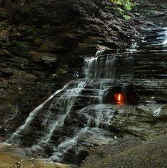 Eternal Flame Falls, near Buffalo, NY, sits on a pocket of methane gas, which seeps out through a crack in the rocks behind the waterfall. Every once in awhile, the flame goes out (perhaps it's not so eternal), but it doesn't take long before a visitor or local relights it. (Description: GoalZero)