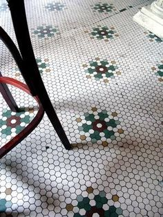 Antique hex tile floor with snowflake pattern at Dollop Coffee Co. in Chicago.