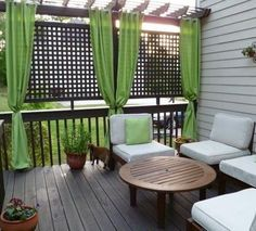 I like the idea of the lattice to give privacy with the curtains....porch idea