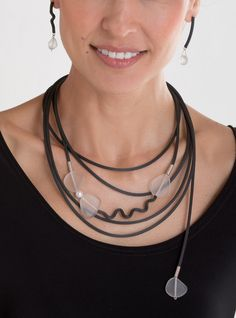 Frozen in Time Necklace by Dagmara Costello. Recycled glass beads, pearl, and sterling silver contrast with black rubber tubing, adding a playful splash of texture to the modern, asymmetrical design of this handcrafted jewelry. Necklace has magnetic clasp.