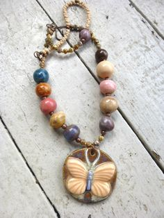 Ceramic pendant, beads with peanut glass beads, bronze beads, copper flower beads, Glass Czech Picasso beads, seed beads and clasp
