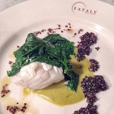 ERMO COLLE - BACCALA IN OLIOCOTTURA SALSA DI FREGGITELLI QUINOA NERA & SPINACI  Olive Oil Pached Sat Cod with Friggitello Pepper Sauce Black Quinoa & Spinach. I couldn't get enough of this exquisite dish last night at the @identitagalose event at @eatalyusa  Dish was prepared by Moreno Cedroni of La Madonnina del Pescatore in Senigallia Italy  Flatiron NYC #GranaPadano #GatherwithGrana #eatalynyc #identitaeataly by dingster.eats