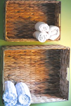 Hang Baskets on the wall for quick and inexpensive towel storage (Easy Bathroom Updates on a Dime!)