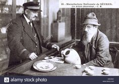 Download this stock image: Artisan painter of decorated Sevres Porcelain, France - pictured with the factory doorman (?).     Date: circa 1910s - G3CW21 from Alamy's library of millions of high resolution stock photos, illustrations and vectors.