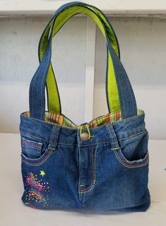 Designer's Tote Pattern – Made from Upcycled Jeans – Form & Fashion America This upcycled denim purse is an attention-grabber. Sewing Pattern to turn your Jeans into a Purse – Form and Fashion America Exceptional 50 Sewing projects are availa Denim Handbags, Cute Handbags, Cheap Handbags, Cheap Bags, Purses And Handbags, Cheap Purses, Spring Handbags, Ladies Handbags, Trendy Handbags