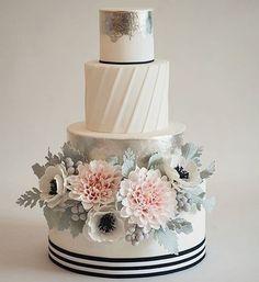 Wow! What a beautiful and unique creation by @heartsweetcakes! #Bridebook #cake #weddingcake #weddingideas #weddinginspiration #bridebookcakes #flowers #wednesday #beautiful #love #engaged #food #foodart
