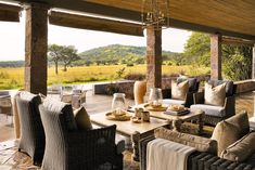 Singita Serengeti House, located on the slopes of Sasakwa Hill in the expansive acre Grumeti Reserves, is an exclusive-use retreat. Sustainable Tourism, Neutral Palette, Outdoor Dining, Acre, Terrace, Table Decorations, Luxury, Tanzania, Cottages
