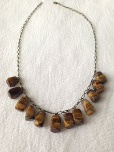Tiger Eye and Brass Drop Necklace. $25.00, via Etsy.