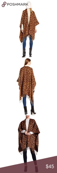 AK Anne Klein Leopard Split Wrap With Fringe Brand new , super cozy and elegant wrap / scarf. Stay on-trend in this animal print wrap, featuring a cute fringed hem.  Size: One Size Color: Jasper/Mocha/Chocolate The world of anne Klein has come to encompass women's wear, accessories, eyewear, watches, Legwear and more. Her clothing does more than simply meet a woman's fashion needs; it provides women with a form of self-expression and confidence. Today anne Klein reflects the original brand…