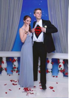 Taking Superman To Prom. Soooo cute. Okay that would have been so awesome.