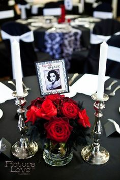 love the feathers and the red/black combo Tablescape Centerpiece  www.tablescapesbydesign.com https://www.facebook.com/pages/Tablescapes-By-Design/129811416695