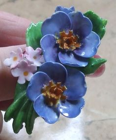 A bit bigger photograph of the blue flowers in this lovely bone china vintage brooch. Sold