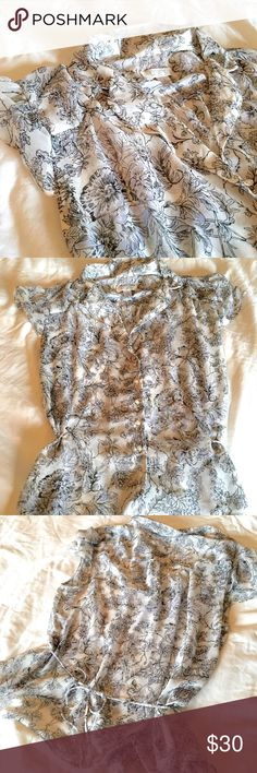 Ann Taylor LOFT Sheer Floral Tie Back Blouse Ann Taylor LOFT feminine winter white, gray, lavender and black floral sheer blouse. Ties at back or side. Size 12. Fits more like a 10. LOFT Tops Blouses