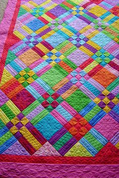 9 Patch and Rails by Jessica's Quilting Studio via Flickr - love the colors!  What a great quilt for a young person ... So cheerful!