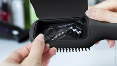 """Brush with a compartment for clips, bobby pins, and hair ties."""