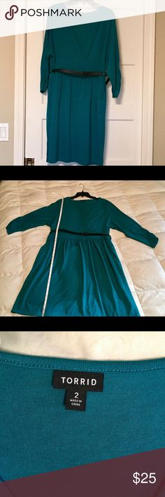 "Never been worn, teal lite weight dress. Stretchy-soft teal knit dress with long sleeves. gathered waist with pockets and a black faux leather belt. Approximately 37"" long from the shoulders. torrid Dresses Long Sleeve"