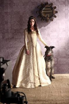 """A behind-the-scenes shot of Adelaide Kane, star of The CW's new show """"Reign,"""" and Sterling, a loyal royal pup. ad"""